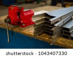 metal sheets and red vise | Shutterstock . vector #1043407330