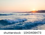 beautiful sunset over sea with... | Shutterstock . vector #1043408473