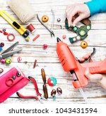woman makes an ornament from... | Shutterstock . vector #1043431594