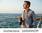 young pensive man in sportswear ... | Shutterstock . vector #1043444299