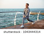 handsome concentrated man in... | Shutterstock . vector #1043444314