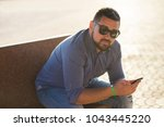 male 35 years old in the city... | Shutterstock . vector #1043445220