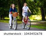women biking in city park  | Shutterstock . vector #1043452678