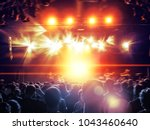 concert hall with a lit stage... | Shutterstock . vector #1043460640