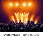concert hall with a lit stage... | Shutterstock . vector #1043460649