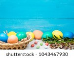 easter eggs in a basket ... | Shutterstock . vector #1043467930