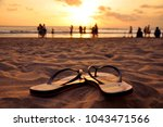 Small photo of Beautiful capture of flip flops in the sand on Seminyak beach, Bali, Indonesia