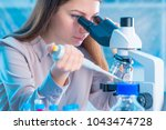laboratory assistant with a... | Shutterstock . vector #1043474728