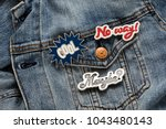 close up view of denim jacket... | Shutterstock . vector #1043480143
