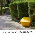 yellow plastic box for sand | Shutterstock . vector #1043483428