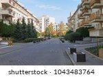 a small street of the modern... | Shutterstock . vector #1043483764