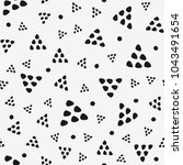 seamless pattern with triangles ... | Shutterstock .eps vector #1043491654