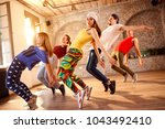 group of dancers dancing... | Shutterstock . vector #1043492410