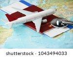 boarding pass and a passport... | Shutterstock . vector #1043494033