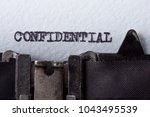 confidential word typed on old... | Shutterstock . vector #1043495539