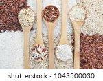 mix of rice grains varieties ... | Shutterstock . vector #1043500030