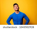 portrait of young asian boy... | Shutterstock . vector #1043502928