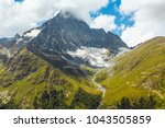 mount peak in a dense clouds | Shutterstock . vector #1043505859