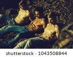 three handsome young macho men... | Shutterstock . vector #1043508844