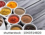 colorful spices in ceramic... | Shutterstock . vector #1043514820