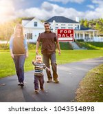 happy mixed race family walking ... | Shutterstock . vector #1043514898