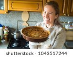young woman holding a baking... | Shutterstock . vector #1043517244