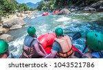 white water rafting with a team ... | Shutterstock . vector #1043521786