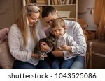 happy family playing with... | Shutterstock . vector #1043525086