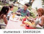 happy young family having... | Shutterstock . vector #1043528134