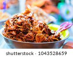 fried meat pieces in the street ... | Shutterstock . vector #1043528659