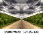 Country road dark clouds HDR - stock photo