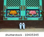 Shoes in front of Buddhist temple, Seoul, South Korea - stock photo