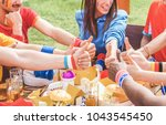 football supporters from... | Shutterstock . vector #1043545450