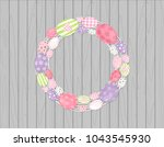 easter eggs wreath hanging on...   Shutterstock .eps vector #1043545930