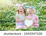 easter egg hunt in spring... | Shutterstock . vector #1043547100