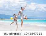 mother and child playing at... | Shutterstock . vector #1043547313