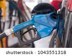 gasoline car refill on the gas... | Shutterstock . vector #1043551318