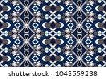 ikat geometric folklore... | Shutterstock .eps vector #1043559238