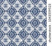 ikat seamless pattern. vector... | Shutterstock .eps vector #1043559523