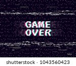game over glitch background.... | Shutterstock .eps vector #1043560423