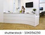 front desk lady doing her job... | Shutterstock . vector #104356250