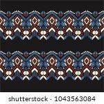 ikat geometric folklore... | Shutterstock .eps vector #1043563084