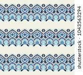 ikat geometric folklore... | Shutterstock .eps vector #1043563294