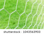 the nets of football goal with... | Shutterstock . vector #1043563903