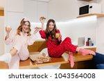 refined white girl in red... | Shutterstock . vector #1043564008