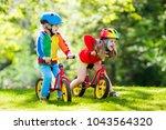 children riding balance bike.... | Shutterstock . vector #1043564320