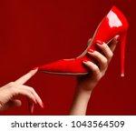 woman hands hold red high hill... | Shutterstock . vector #1043564509
