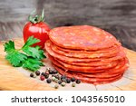 sliced of chorizo on a wood... | Shutterstock . vector #1043565010