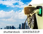 charging modern electric car on ... | Shutterstock . vector #1043565319