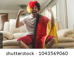 german fan watching a soccer... | Shutterstock . vector #1043569060